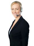 Call centre excutive posing with headsets Royalty Free Stock Photo