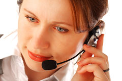 Call centre executive. Closeup portrait of a yound beautiful call centre executive with headset, isolated over white background Stock Photos