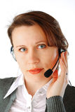 Call centre executive. Closeup portrait of a young business woman with headset, isolated over white background Stock Image