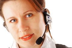 Call centre executive. Closeup portrait of a young business woman with headset, isolated over white background Stock Images