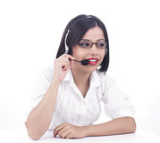 A call centre female executive. A pretty female call centre worker of indian origin royalty free stock image