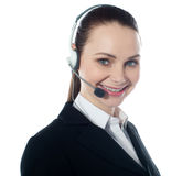 Call centre female executive, closeup. Isolated over white Stock Images