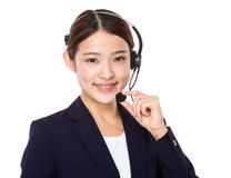 Call centre operator with hand hold with microphone Stock Image
