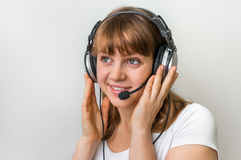 Call centre operator with headset at workplace in call center Royalty Free Stock Photo