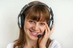 Call centre operator with headset at workplace in call center Stock Photography