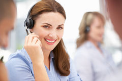 Call centre operator helping customer