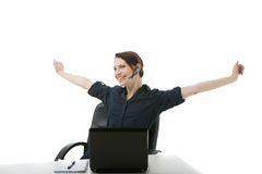 Call centre operator stretching her arms Royalty Free Stock Images