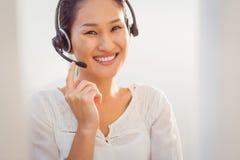 Call centre representative using headset Royalty Free Stock Photo