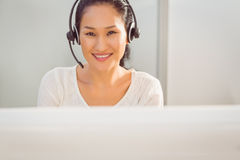 Call centre representative using headset Royalty Free Stock Photography