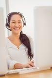 Call centre representative using headset Stock Photo