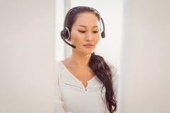 Call centre representative using headset Stock Photography