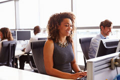 Call centre staff working in an open plan office Royalty Free Stock Images