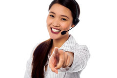 Call centre support staff pointing towards camera Royalty Free Stock Image