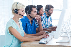 Call centre workers on their laptops Stock Image