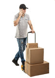 During a call - Courier hand truck boxes and packages royalty free stock photography