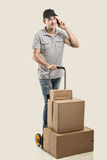 During a call - Courier hand truck boxes and packages Stock Images