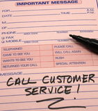 Call Customer Service Message. Call Customer Service written on a pink Important message pad Royalty Free Stock Photos