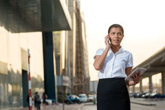 Call the customer. Successful businesswoman standing in the stre Stock Images