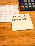 Call an electrician, Post it reminder, copy space Stock Images