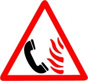 Call firestation if you see fire flame illustrated Icon triangle road signn isolated on white Background Royalty Free Stock Photography