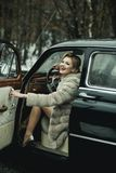 Call girl in vintage car. call girl with stylish hair and fashionable makeup. Call girl in vintage car. call girl with stylish hair and fashionable makeup royalty free stock photo
