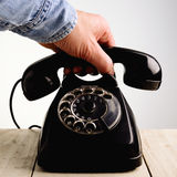 Call. Hand that picks up the phone stock photos
