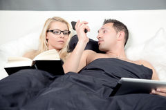 Call handover. A Business Man hands over the Phone call to her wife in there bed Stock Images