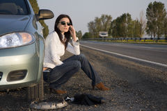 Call for help. Woman calling for help from the road Royalty Free Stock Photos