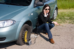 Call for help. Woman with damaged car calling for help Stock Photography