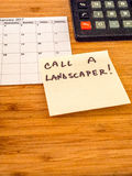 Call a landscaper, Post it reminder, copy space. Call a landscaper, calendar, calculator, post it Stock Photos