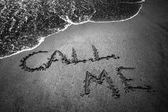 Call me. Beach writing stock photo