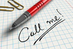 Call me!. Close view of red ball point pen on notice paper with Call me! message Stock Photo