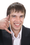 Call me!. Attractive smiling young business man making a Call Me sign with his hand royalty free stock photography
