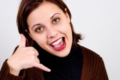 Call me. Happy girl making the call me gesture Royalty Free Stock Photo