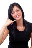 Call Me. Beautiful Young Woman With Black Hair Making A Call Me Sign stock photo