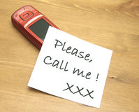 Call me. Someone asks a lover by note to call stock image