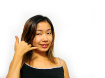Call Me?. Asian girl doing a call me sign Royalty Free Stock Photo