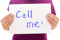Call me. Girl holding white paper sheet with text Call me Stock Photography