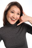 Call me hand signal from beautiful smiling woman Royalty Free Stock Images