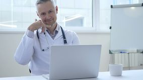 Call me for help gesture by doctor in clinic. 4k , high quality stock video footage