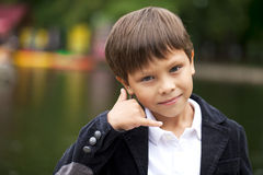 Call Me, Little Boy making a call me gesture Royalty Free Stock Photo