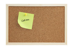 """Call me Note. Yellow sticky / adhesive note with a """"Call me"""" message pinned on a cork board isolated on white background. Enough copy space for you to play Stock Photo"""