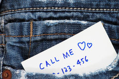 Call me note. In a blue jeans pocket stock photos
