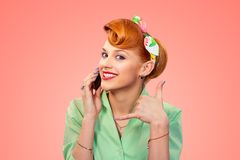 Call me. Pin up style girl with phone royalty free stock photography