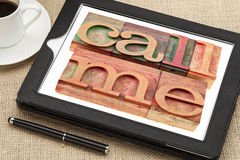 Call me request or reminder. Words in vintage wooden letterpress printing blocks on a digital tablet with a cup of coffee stock images