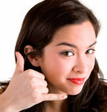 Call Me Sign. A beautiful brunette is doing a call me sign Stock Image