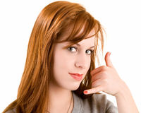 Call Me Sign. A beautiful redhead lady is doing a call me sign Stock Photos