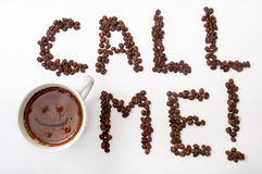 Call me sign with coffee beans and cup of coffee over white back Royalty Free Stock Photo