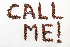Call me sign with coffee beans over white background.  Royalty Free Stock Photography