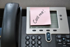 Call Me Telephone. A office telephone with a call me post it. Capable of teleconferencing Royalty Free Stock Photos